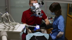 People working as dentist and medical assistant - stock footage