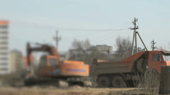 Excavator uploads a clay in a truck using a bucket Stock Footage
