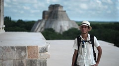 Man walking among the Mayan ruins Stock Footage