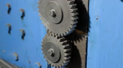 Gears are spinning on a machine Stock Footage