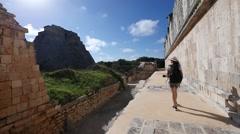Girl walks among the Mayan ruins Stock Footage