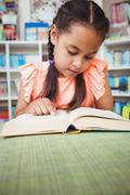 Close up of little girl reading a book - stock photo