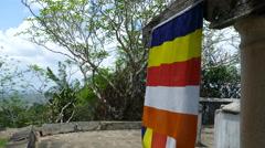 Buddhism flag at Mulkirigala Raja Maha Vihara - stock footage