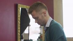 Professional hairdresser comb top of hair to blonde girl in beauty saloon - stock footage