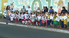 Kids watch olympic torch parade - Rio 2016 Stock Footage