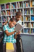 Little boys reading a book - stock photo