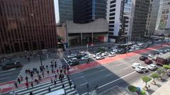 Sao Paulo, Brazil. Paulista Avenue. Crossing, pedestrian, cars, traffic - stock footage