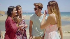 Group of six young people relaxing on holiday Stock Footage