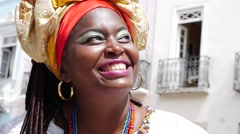 Brazilian woman of African descent wearing traditional clothes from Bahia Stock Footage