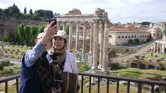 Asian couple tourists take selfie on ancient antique columns of Rome Empire Stock Footage