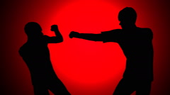 Profile of two men fist fighting - stock footage