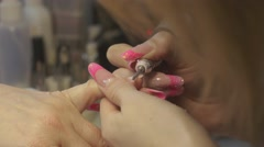 Nail master purge off cover out of nails in beauty saloon by special apparatus - stock footage