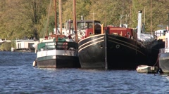 Boat houses in amsterdam canal Stock Footage