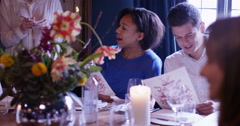 4k, Waiter taking order from couple at restaurant table. Slow motion. - stock footage