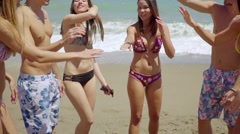 Cute teenagers in bathing suits on beach Stock Footage