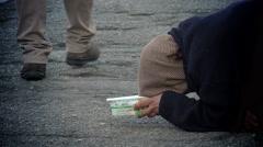 beggar woman in the street: homeless, begging to people begging in knee - stock footage