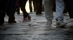 feet and legs of people walking on ancient way of the center of Rome - stock footage