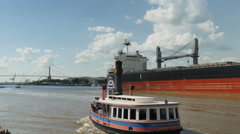 4K Ferry Passes Bulk Carrier Ship On Savannah River - stock footage