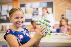 Child posing with an atom Stock Photos