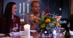 4K Happy group of friends chatting & laughing in sophisticated restaurant - stock footage