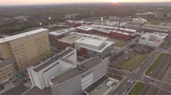 Downtown aeria footage above Durham, NC in spring at sunset. Stock Footage