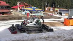 BANSKO, BULGARIA - Ratrac tractor begins preparing ski slope Stock Footage