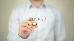 Self Made Millionare, Man Writing on Transparent Screen - stock footage