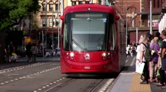 Sydney Light Rail train picks up passengers and moves on.  Time Lapse - stock footage