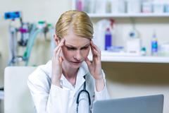 A woman vet reflecting Stock Photos