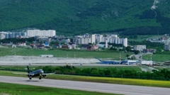 Passenger plane takes off from the airfield Gelendzhik, takes off the ground Stock Footage