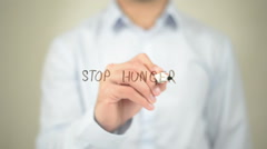 Stop Hunger, Man Writing on Transparent Screen Stock Footage