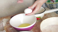 Woman Cook Breaks Egg in a Home Kitchen Stock Footage