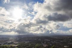 aerial top view of urban city with clouds and sun light reflect - stock photo