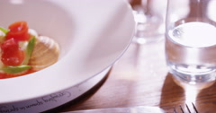 4K Close up on a delicious freshly prepared plated meal in a gourmet restaurant. Stock Footage