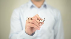 The End, Man Writing on Transparent Screen - stock footage