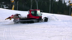 Snowcat preparing a slope at skiing resort Stock Footage