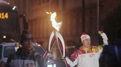 Relay race Olympic flame in Saint Petersburg in October. Torchbearers pass flame Stock Footage