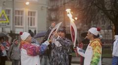 Relay race Olympic flame in Saint Petersburg in October. Bari Alibasov pass Stock Footage