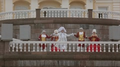 Men and lady in historical old royal dresses, in white periwigs walk on marble Stock Footage