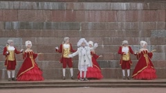 Men and lady in historical old royal dresses, in white periwigs perform on Stock Footage