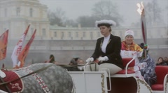 Relay race Olympic flame in Saint Petersburg. Torchbearer on carriage wave hand - stock footage