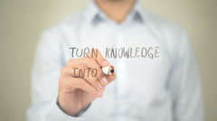 Turn  knowledge into Action, Man Writing on Transparent Screen - stock footage