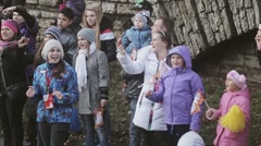 Many teens, adults shoot on camera, clap, wave hands. Event. Audience. Autumn Stock Footage