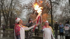 Relay race Olympic flame in Saint Petersburg. Torchbearer pass flame to Bari Stock Footage