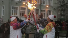 Relay race Olympic flame in Saint Petersburg. Bari Alibasov pass flame to Stock Footage