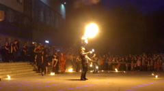 Fire show. Young man firebreathing, slow motion Stock Footage
