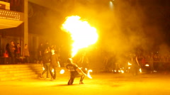 Fire show with fire dancers. Young man firebreathing. Stock Footage
