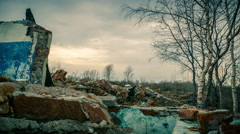 Apocalypse. Gloomy sky over the remains of destroyed buildings - stock footage