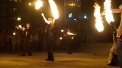 Slow motion. Beautiful fire show. Dancers group juggles with fire Stock Footage