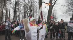 Relay race Olympic flame in Peterhof, Saint Petersburg. Anastasia Volochkova Stock Footage